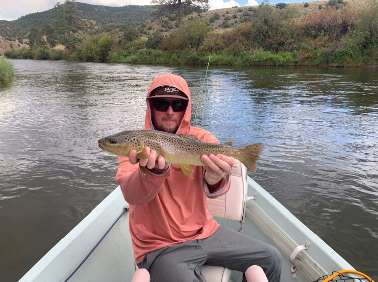LD Zimmerman, Ski Tech and Bartender at Gore Range Sports catches a fish while fly-fishing
